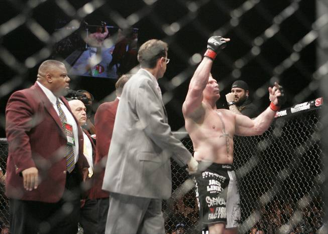 Brock Lesnar flips off the audience after beating Frank Mir in their heavyweight title fight at UFC 100. Lesnar won with stoppage in the second round.