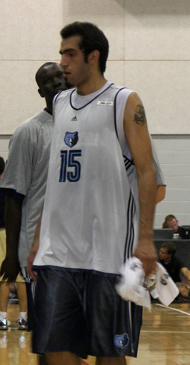 Hamed Haddadi, the first Iranian to play in the NBA, leaves a Memphis huddle Sunday at the Summer League at Cox Pavilion.