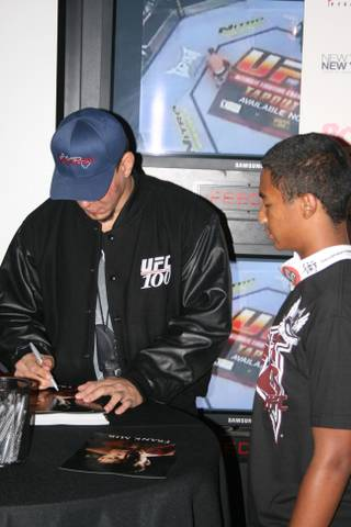 Frank Mir poses for pictures and signs autographs for fans at ESPN Zone at New York New York following UFC 100.