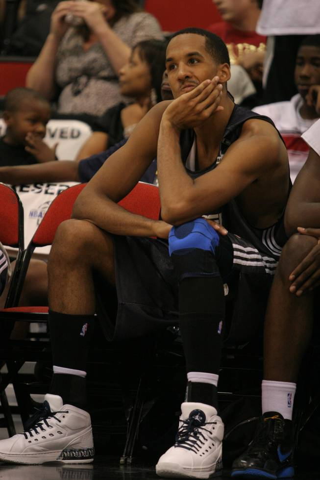 Oklahoma City Thunder guard Shaun Livingston takes a moment on the bench in the closing moments of an 86-57 loss on Sunday at Cox Pavilion in NBA summer league play. Livingston is now just over two years removed from a nasty injury to his left knee which temporarily de-railed a promising NBA career. He signed a multi-year deal with the Thunder mid-way through the 2008-09 campaign.