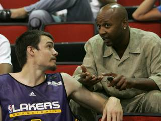Adam Morrison of the Los Angeles Lakers (left) talks with Lakers assistant coach Brian Shaw at the NBA Summer League in the Cox Pavilion.