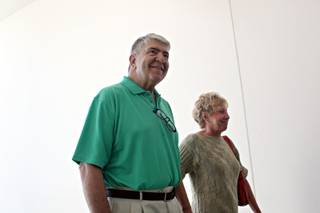 The first patient, Randy Capurro, left, and his wife, Netty, are welcomed to the Cleveland Clinic Lou Ruvo Center for Brain Health, in Las Vegas on Monday morning, July 13, 2009.