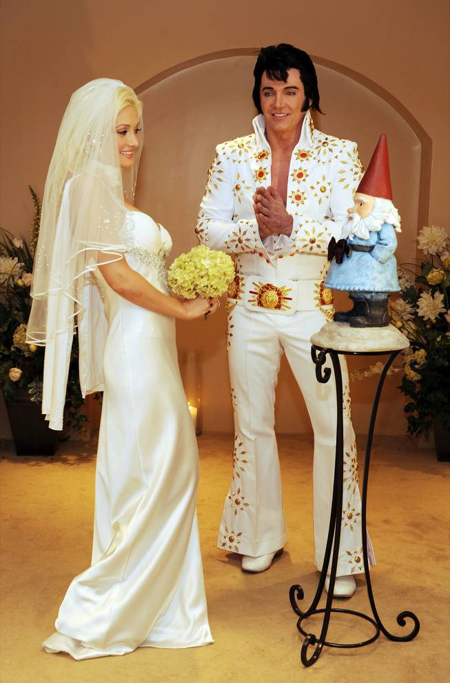 Holly Madison ties the knot with the Travelocity gnome as Elvis impersonator Tim Welch officiates at The Wedding Chapel at Planet Hollywood Resort & Casino on July 12, 2009, in Las Vegas.
