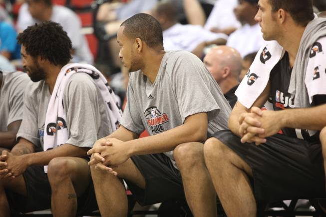 Lorrenzo Wade, center, watches the action during the NBA summer league. The San Diego State product and Cheyenne High grad has registered just 11 minutes in 4 games so far with the Milwaukee Bucks.