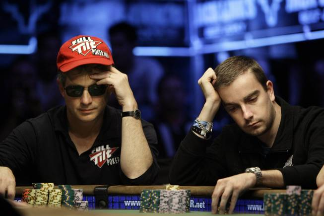 Steven Begleiter, left, and Antoine Saout play a hand during the World Series of Poker at the Rio Hotel and Casino in Las Vegas on Wednesday, July 15, 2009.