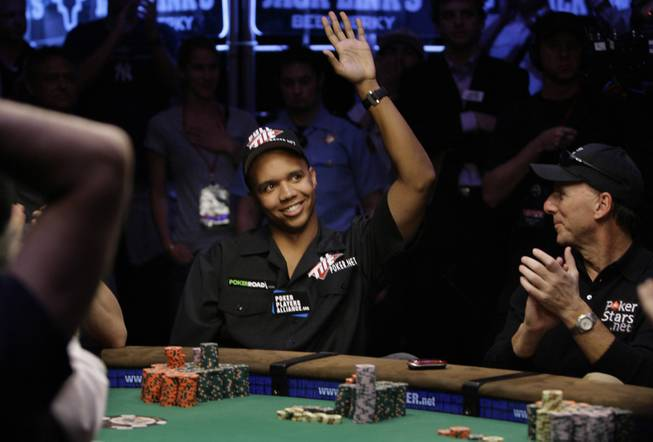 Phil Ivey waves to supporters after finishing in the final nine at the World Series of Poker at the Rio Hotel and Casino in Las Vegas on Wednesday, July 15, 2009.