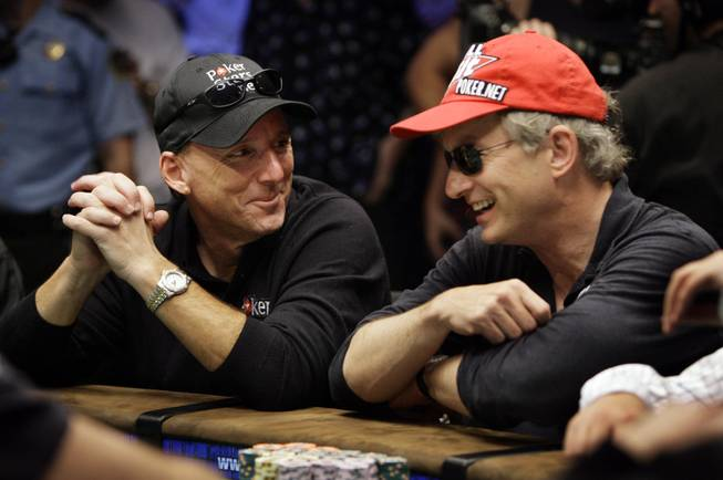 Kevin Schaffel laughs with Steven Begleiter after the two made the final table at the World Series of Poker at the Rio Hotel and Casino in Las Vegas on Wednesday, July 15, 2009.