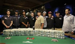 Players who made the final table of the World Series of Poker pose for a photograph at the Rio Hotel and Casino in Las Vegas on Wednesday, July 15, 2009. They are from left, James Akenhead, Jeff Shulman, Phil Ivey, Antoine Saout, Darvin Moon, Joseph Cada, Steven Begleiter, Kevin Schaffel and Eric Buchman.