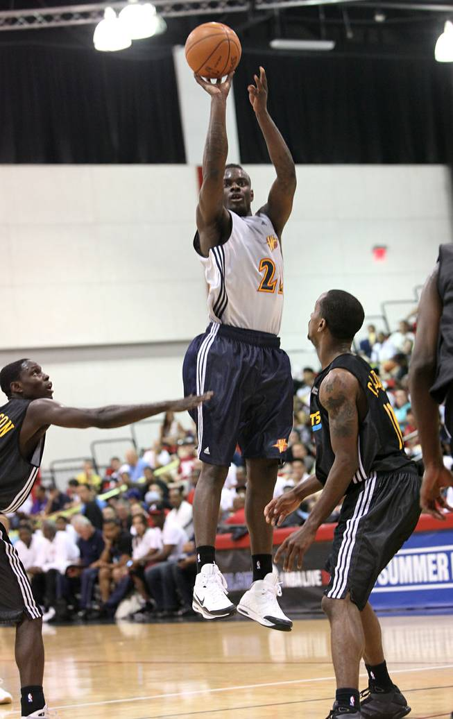 Warriors guard Anthony Morrow hoists one of his 9 3-point attempts Thursday in an NBA summer league contest against New Orleans at Cox Pavilion. Morrow connected on 7 of them en route to scoring a summer league record 47 points in the victory. A year ago, he came to the summer league with New Orleans as a relative unknown and went on to lead the NBA in 3-point field goal percentage last season.
