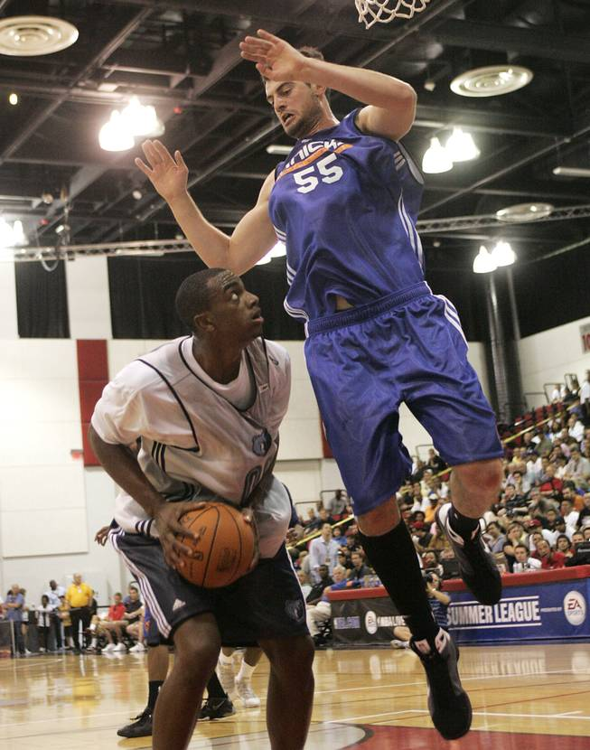 Memphis Grizzlies forward Darrell Arthur head-fakes against New York's Nikoloz Tskitishvili during a 90-86 victory over the Knicks on Tuesday at Cox Pavilion in NBA summer league play. Arthur, who has flashed a new, outgoing nature on the floor this summer, had 22 points, 6 rebounds and 3 blocks in the win.