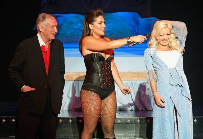 Hugh Hefner, Shoshana Bean and Holly Madison in <em>Peepshow</em> at Planet Hollywood.