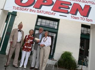 The Boulder Dam Hotel, which closed for lack of funds on July 11, will reopen after receiving a donation of $260,000 on Monday from an anonymous donor. From left: attorney Ralph Denton, gift shop manager Marie Sullivan, Darryl Martin, president of the Boulder City Museum and Historical Association, and his wife, Sara Denton, a founding member of the Boulder City Museum and Historical Association.