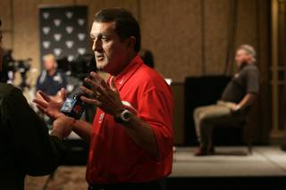 UNLV head football coach Mike Sanford speaks to the media during the Mountain West Conference Media Day on July 21, 2009.