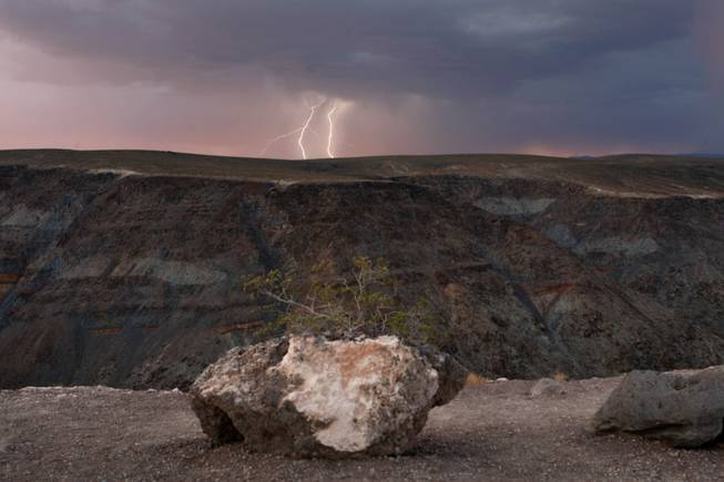 Lightning strikes over a ridge as a storm passes though Death Valley National Park in California just after sunset July 21, 2009.