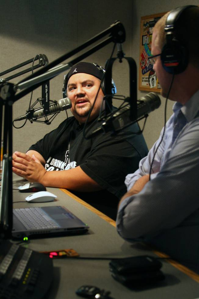 "Iglesias chats with Xtreme 107.5 FM's Jason ""Mahoney"" Gentry during a six-stop media blitz to promote his July 25 show at the Pearl at the Palms."