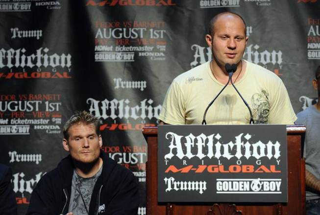Mixed martial arts heavyweight fighters Josh Barnett (left) and Russia's Fedor Emelianenko appear in New York on June 3, 2009, during a press conference for Affliction's August event in Anaheim, Calif. The event and fighting promotion were canceled after Barnett tested positive for a banned substance.