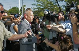 Los Angeles homicide detective Greg Strenk speaks to the media Tuesday outside the Las Vegas offices of Dr. Conrad Murray, Michael Jackson's personal doctor. Authorities entered the medical office as part of a manslaughter investigation into the Michael Jackson's death.