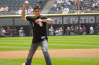 WEC bantamweight champion Miguel Torres throws out the first pitch at Thursday's historic Chicago White Sox game. Following Torres' lead, White Sox star Mark Buehrle threw an epic perfect game, leading Chicago past Tampa Bay 5-0.