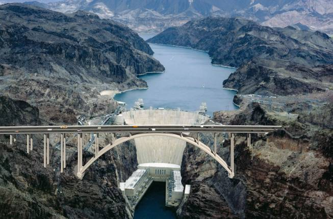 A computer rendering of the completed bridge against the Hoover Dam.