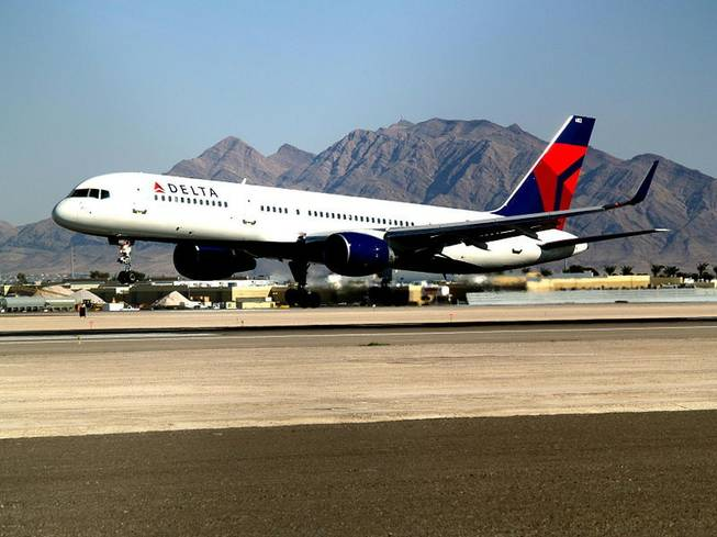 The Delta Air Lines Boeing 757 passenger plane in this photo from 2007 at McCarran International Airport is similar to the one that made an emergency landing Sunday afternoon at McCarran when smoke was smelled in the cockpit shortly after takeoff.