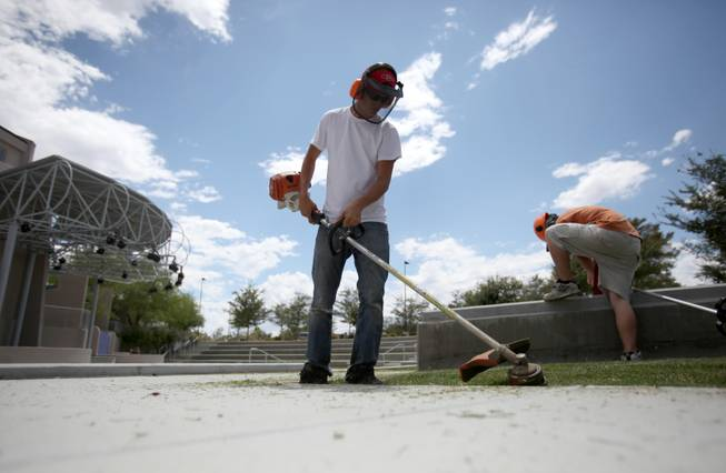 Mason Groves, a Boulder City High School senior, is one of almost 50 teenagers Boulder City has hired as part of the Workforce Investment Board's teen summer job program. Groves works on city landscaping crews.