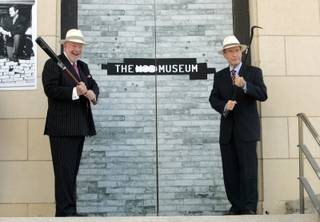 Las Vegas Mayor Oscar Goodman, left, and former Sen. Richard Bryan (D-Nev.) prepare to open the doors to the Mob Museum during a news conference at the museum site in downtown Las Vegas this morning.