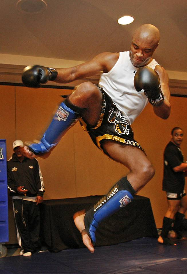 Fighters with the Ultimate Fight Championship hold workouts at the Loews Hotel in Center City Philadelphia on Wednesday afternoon August 5, 2009. Pictured is Anderson Silva, a light heavyweight fighting out of Curitiba, Brazil. He is shown flying through the air as attempts to kick a heavy bag.