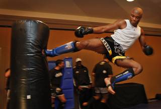 Fighters with the Ultimate Fight Championship hold workouts at the Loews Hotel in Center City Philadelphia on Wednesday afternoon August 5, 2009. Pictured is Anderson Silva, a light heavyweight fighting out of Curitiba, Brazil. He is shown flying through the air as he kicks a heavy bag.