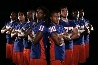 The Bishop Gorman High football team is expected to have eight sign national letters of intent to play college football. They included, from left, Geoffrey Gibson (Cal), Evan Palelei (Navy), Alex Turner (Stanford), Taylor Spencer (UNLV), Victor Belen (Samford), Tim Gulley (uncommitted), Jalen Grimble (a junior with multiple offers) and Xavier Grimble (USC). Not pictured are Tim Wilkinson (Northern Arizona) and Ian Bobak (UNLV).