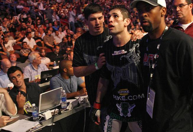 Fans of mixed martial arts and the UFC, gather at the Wachovia Center on Saturday evening August 8, 2009 for a night of fighting. Battle between welterweights on the main card, Johnny Hendricks and Amir Sadollah. Sadollah is escorted away from the Octagon after his defeat.