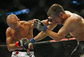 BJ Penn clocks opponent Kenny Florian during their main event bout Aug. 8, 2009, at the Wachovia Center. Penn went on to win, retaining his championship belt.
