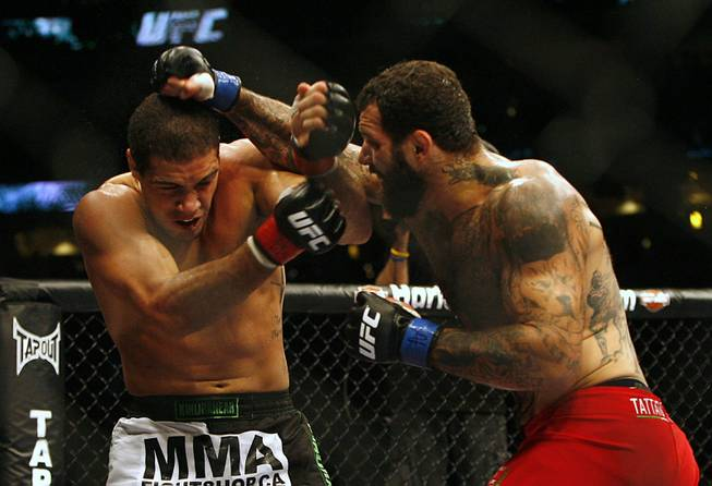 Fans of mixed martial arts and the UFC, Ultimate Fighting Championship gather at the Wachovia Center on Saturday evening August 8, 2009 for a night of fighting. Battle between middleweights Alessio Sakara and Thales Leites. Winner Sakara. (with beard) Sakara is pictured at right punching Leites.