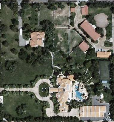 The property is bordered by Tomiyasu Lane to the west and Maule Avenue to the north. The main gate, off Tomiyasu, leads up the circular driveway to the main residence (with pool in back). At the southeast corner is the car museum. The northeast quadrant includes equestrian and canine facilities. The building to the northwest, with a gated driveway on Maule, is a 3,000-square-foot guest villa.
