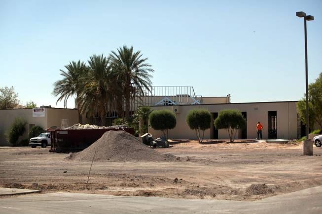 Workers renovate the Church of Scientology's future home in August near Emerson and Eastern avenues. The church in October 2005 purchased the 3.71-acre parcel for $2.9 million from a synagogue that has since moved to Henderson, according to county records.