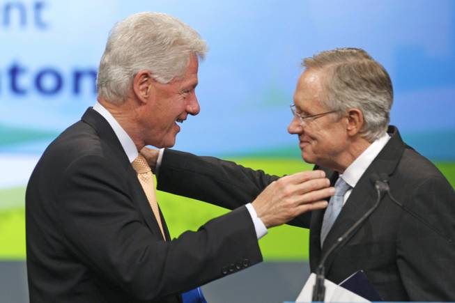 Former President Bill Clinton is greeted by Senate Majority Leader Harry Reid on Aug. 10 at the National Clean Energy Summit 2.0 at UNLV.