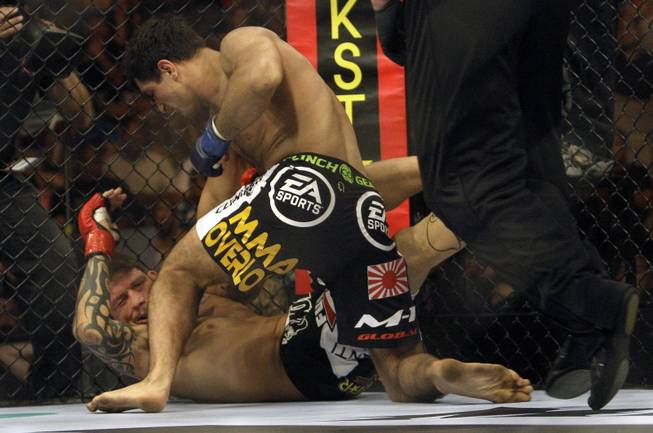 "Gegard Mousasi, top, punches Renato ""Babalu"" Sobral during a Strikeforce mixed martial arts Light Heavyweight Championship match on Saturday, Aug. 15, 2009, in San Jose, Calif. Mousasi won by TKO in the first round to win the championship."
