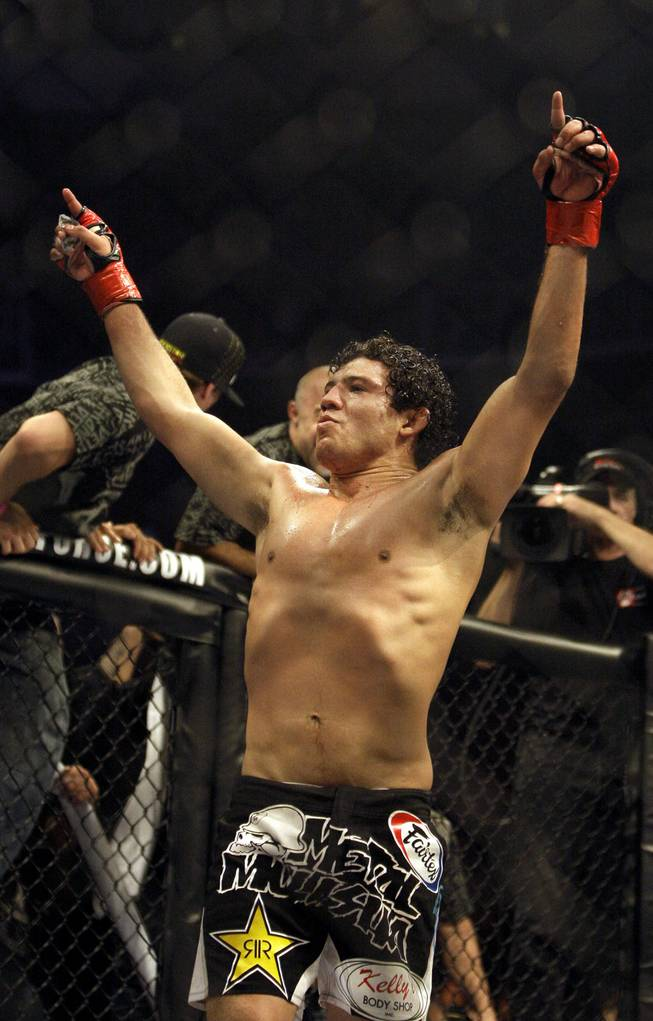 Gilbert Melendez celebrates after beating Mitsuhiro Ishida, of Japan, for the Strikeforce mixed martial arts Interim Lightweight Championship match on Saturday, Aug. 15, 2009, in San Jose, Calif. Melendez won by TKO in the third round.