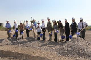 Henderson Libraries Executive Director Tom Fay, center, joins distinguished guests and contractors in breaking ground Tuesday, Aug. 18, 2009, on the 19,919-square-foot new James I. Gibson Library located at Lake Mead Parkway and Water Street.