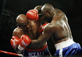 Heavyweight boxers Oliver McCall, left, and Franklin Lawrence battle at the Orleans on Friday. McCall won the 10-round fight by unanimous decision.
