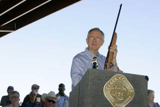 Senate Majority Leader Harry Reid (D-NV) holds up his childhood .22 caliber rifle during the dedication of the Clark County Shooting Park at the north end of Decatur Boulevard Tuesday.