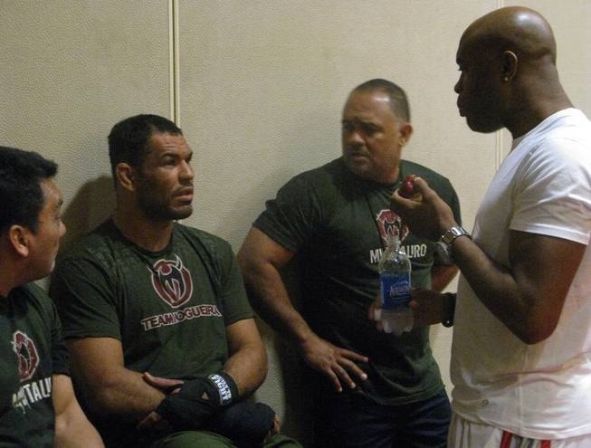 Antonio Rodrigo Nogueira (second from left) talks with UFC middleweight champ Anderson Silva (far right) and trainers during a workout Wednesday, August 26, 2009 at the Portland Marriott Downtown Waterfront in Portland, Ore. Nogueira takes on former UFC heavyweight champ Randy Couture at UFC 102 Saturday night at the Rose Garden Arena.
