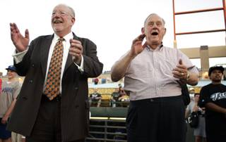 Las Vegas Mayor Oscar Goodman and Reno Mayor Bob Cashell watch the first ceremonial pitches being thrown out before the Las Vegas 51s and Reno Aces game at Cashman Field in Las Vegas on Wednesday.