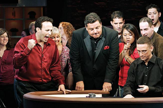 "Adam Ehrlich, 33, of Philadelphia, left, celebrates a hand during NBC's taping Sunday of ""Face the Ace,"" hosted by Steve Schirripa, center, at South Point."