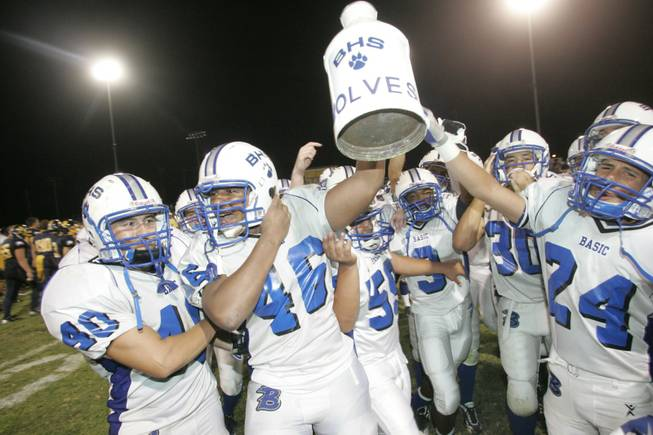 Basic High players celebrate keeping the ceremonial milk jug after defeating rivals Boulder City 26-0.