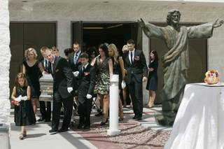 Family members accompany the casket as they file out of the Shrine of the Most Holy Redeemer after the funeral for Station Casinos founder Frank Fertitta Jr. Saturday.