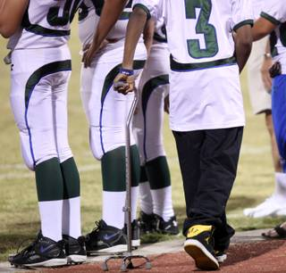 LaQuan Phillips hangs outs on the Green Valley sideline Friday as Green Valley took on Centennial.  Phillips bruised his spine and became temporarily paralyzed last year against Centennial while playing for Green Valley.