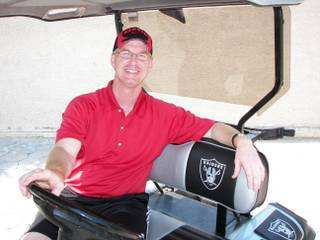 Steve Stallworth, the general manager of the South Point Arena, sits in his custom Oakland Raiders golf cart. The former UNLV quarterback is among a group of locals who will be considered for the next UNLV athletic director post.