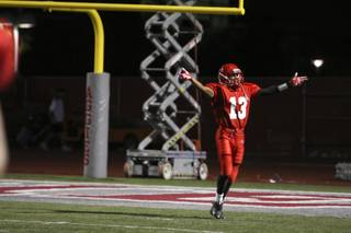 Arbor View full back Thomas Flanagan celebrates after scoring a touchdown in the second half of Thursday's game against Centennial. The Aggies were victorious over the Bulldogs 38-13.