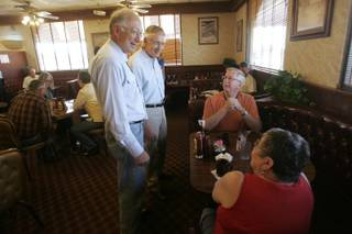 From left, Interior Secretary Ken Salazar and Sen. Harry Reid (D-Nev.) talk Friday with George and Bernice Stewart at the Searchlight Nugget. Reid and  Salazar were in town to formalize payment of $135.9 million for projects throughout Nevada, funded by the auction of federal land in the Las Vegas Valley.