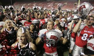 UNLV cheerleaders and players sing the UNLV fight song after defeating Sacramento State 38-3 Saturday at Sam Boyd Stadium.